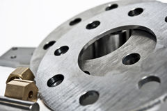 Metal flanges and brass nuts. Milling industry. Close-up. Royalty Free Stock Image