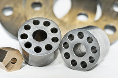 Metal flanges cylinders and brass nuts. CNC milling and lathe industry royalty free stock photo