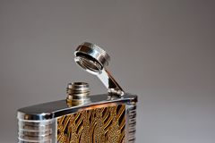 Metal flask for alcoholic drinks closeup shot on gray background stock photos
