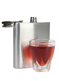 Metal flask and glass. Flat metal flask and whiskey glass on white background Royalty Free Stock Photos