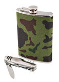 Metal flask and penknife Royalty Free Stock Photos