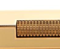 Metal flint golden on gas lighter. Royalty Free Stock Image