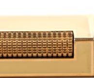 Metal flint golden on gas lighter. Stock Photography
