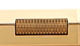 Metal flint golden on gas lighter. Royalty Free Stock Photos