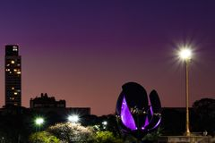 Metal flower in park on a beautiful purple sunset stock photo