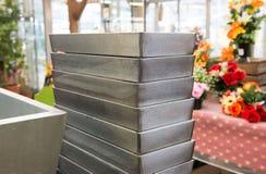 Metal flower pots. Metal flower pots in the garden shop royalty free stock image