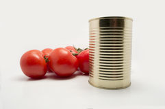 Metal food container with vine tomatoes Stock Photos