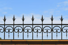 Metal forged fence against the sky Royalty Free Stock Images