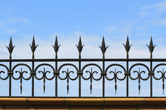 Metal forged fence on the background of sky Stock Photo