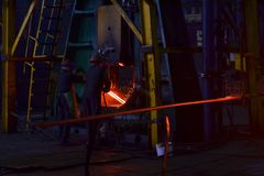 Metal forging, forging shop. Hydraulic hammer shapes the red-hot billet. The production of high-tech parts. Pattern and forms for the artist blacksmith royalty free stock photo