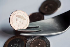 Metal fork with iranian currency. Royalty Free Stock Images