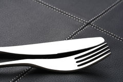 Metal fork and knife with abstract light Royalty Free Stock Photo