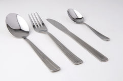Metal fork, knife and spoon isolated. White background Stock Photo