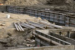 Metal forms in place where a foundation is to be poured. Metal forms for are in place asa footings and foundation is being formed at a construction site stock photos