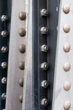Metal frame. Metal plates fastened together with bolts stock photo