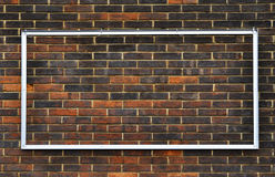 Metal frame on a brick wall royalty free stock images