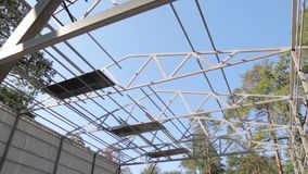 Metal Frame Of Building. On the construction site in the forest with steadicam camera movement stock video
