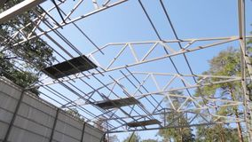 Metal Frame Building. On the construction site in the forest with steadicam camera movement stock video footage