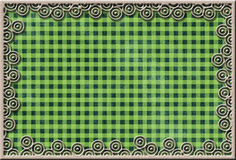Metal frame on checked fabric Royalty Free Stock Photo