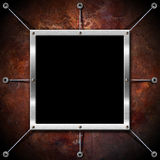 Metal Frame on a Copper Grunge Wall Royalty Free Stock Photography