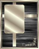 The metal frame on a dark wooden background 2 Stock Image
