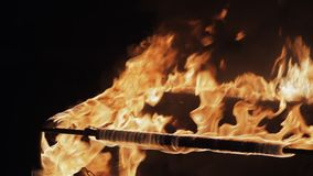 Metal Frame On Fire. A metal frame in the fire at night. Real-time video. Fire show. Fire glow stock video footage