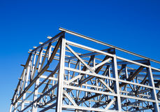 Metal frame of the roof. Against the blue sky royalty free stock photo