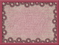Metal frame with suns and stripes background. Metallic pink frame with suns and stripes fabric background Stock Images