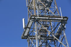 Metal frame of telecommunications tower in front of a dark blue sky Royalty Free Stock Image