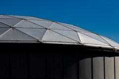 Metal framed domed roof in angled light Royalty Free Stock Image