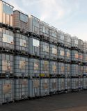Metal framed intermediate bulk containers stacked on pallets waiting to be cleaned or reused in an industrial yard stock photos