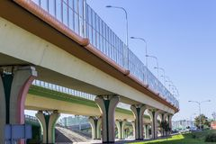 Sound absorbing screens on the highway and overpass and colored concrete pillars. Metal frames filled with glass. Modern technology in Warsaw, Poland royalty free stock photos