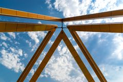 Metal framing against a blue sky.Fragment. stock images