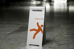 Metal free standing sign slippery floor. On a marble floor Stock Photography