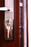 Metal front door. Metal entrance door and lock with keys Stock Images
