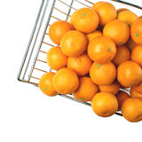 Metal fruit basket on a white background. Tangerines Royalty Free Stock Photo