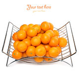 Metal fruit basket on a white background. Tangerines Stock Photo