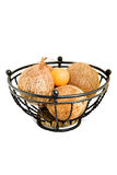 Metal fruit bowl and coconuts Stock Photo