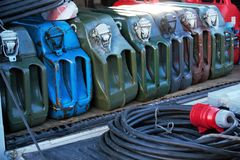 Metal fuel jerrycans and power extander. Colorful canisters for storing and transportation fuel stock photos