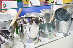 Metal galvanized buckets and kovshs in store. Metal galvanized buckets and kovshs on the counter in the store Stock Photos