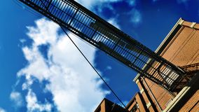 Metal gangway against blue cloudy sky Stock Images