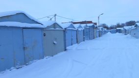 Metal garages in the Russia. N province in the winter stock video