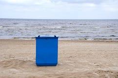 Metal garbage container on sea resort beach Stock Photos