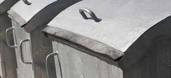 Metal garbage containers. In gray, photo close-up near the private sector Royalty Free Stock Images