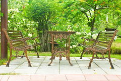 Metal garden chair in beautiful garden Royalty Free Stock Photography