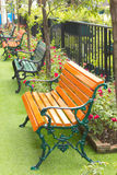 Metal garden chair in beautiful garden Stock Images