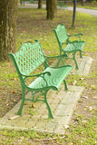Metal garden chair in beautiful garden Stock Photos