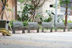 Metal garden chair in the garden stock photography