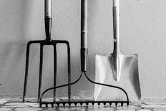 Metal Garden Digging Fork, Metal Garden Rake, Metal Spade royalty free stock photos