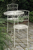 Metal garden furniture. A private patio to relax in the garden Stock Photos
